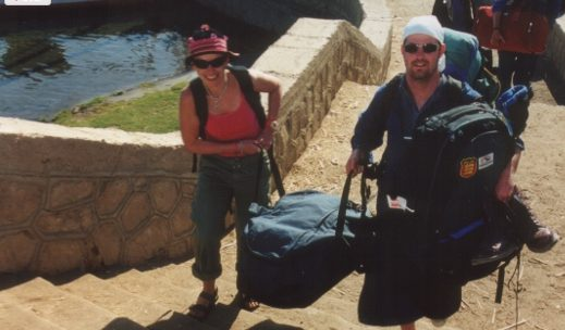 James carrying Alyson's bags up the stairs during that trip to Egypt
