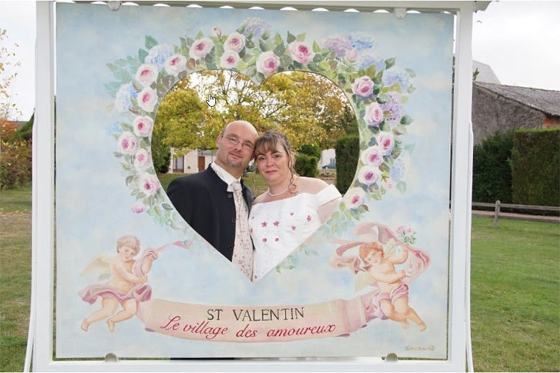 A French couple poses for a photo in the Village of St Valentin
