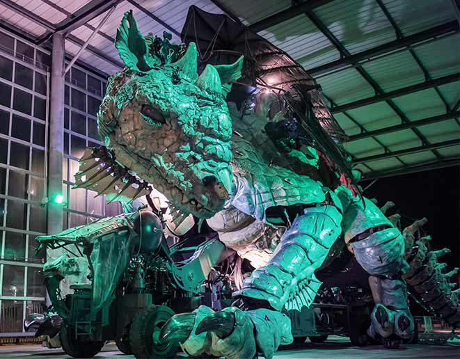 Dragon de Calais lit up green for go green campaign st Patrick's day
