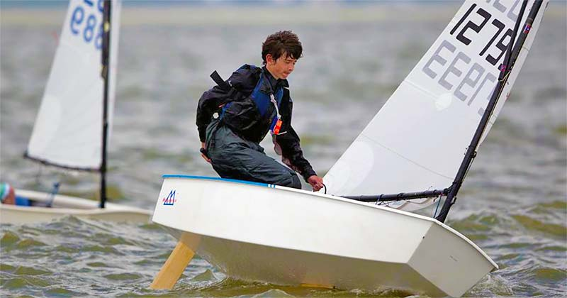 Picture of Kieran sailing his optimist boat at a regatta in the San Francisco Bay