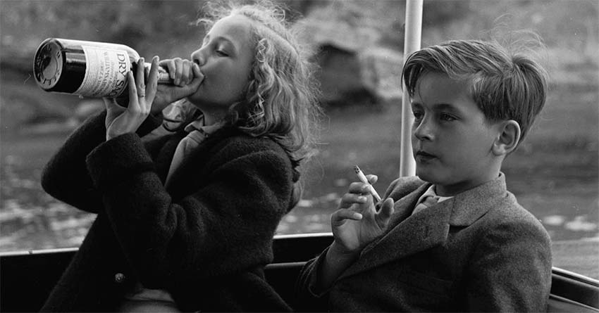 boy and girl on Yacht smoking and drinking