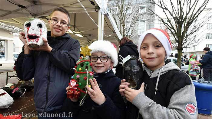 Photo of kids showing off their carved beets for the beet carving competition in France