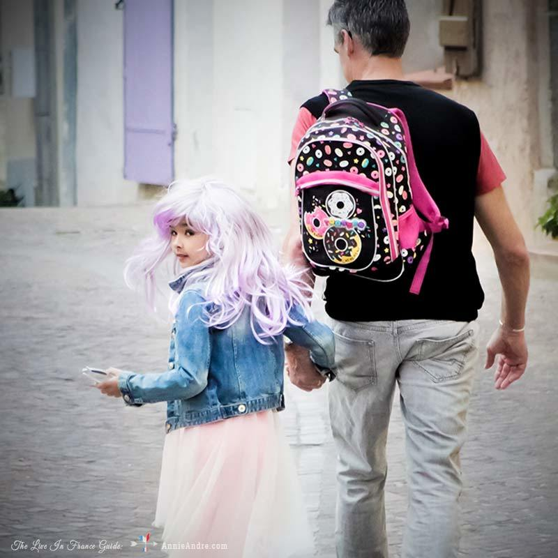 Daddy walking daughter to school on the day of the school carnival. She was super excited.