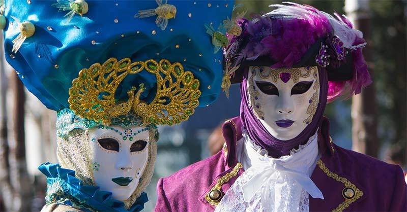 Annecy carnival costumes usually people dress up with beautiful venetian masks.