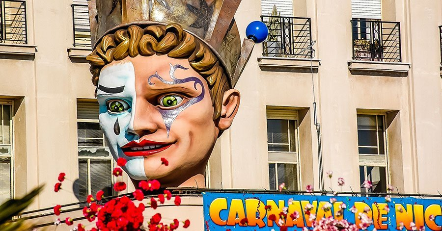 image of mardi gras carnival in Nice France of a giant head, the roi or the king