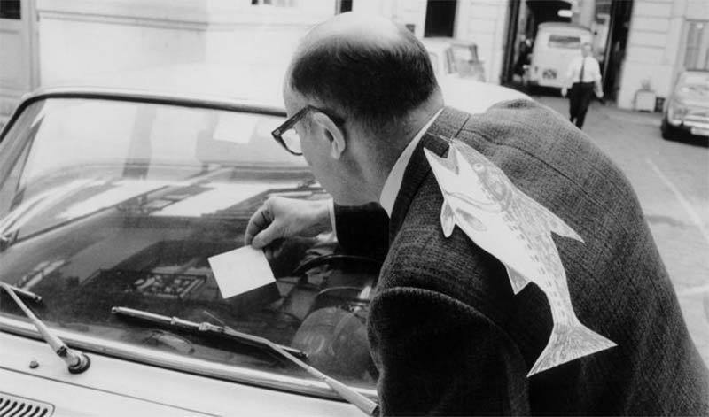 photo of man with a poisson d'avril on his back in Paris 1972