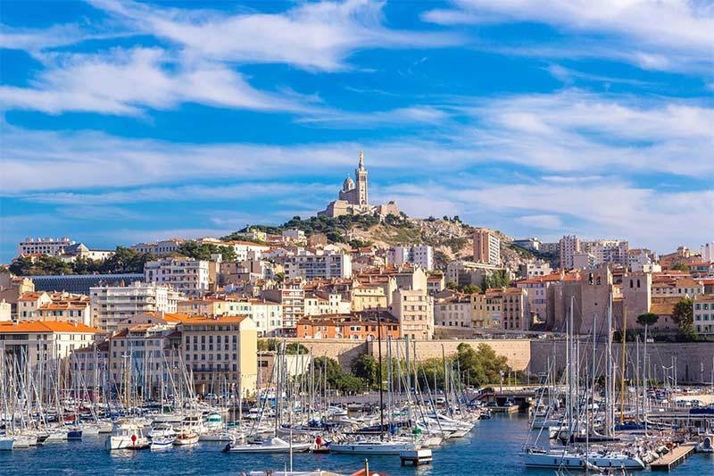 photo of the old port with a view of Marseille Basilique Notre dame de la Garde