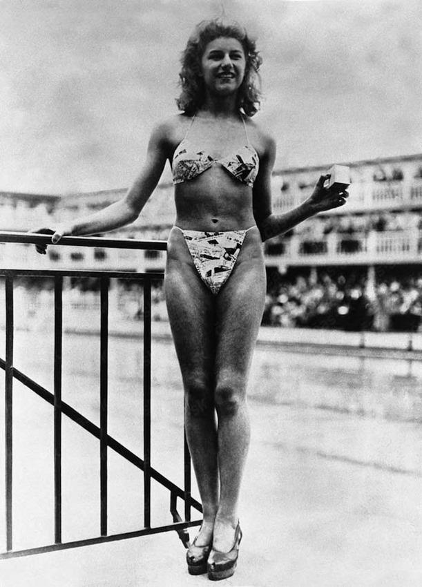Nude dancer Micheline Bernardini models the first bikini in Paris, France