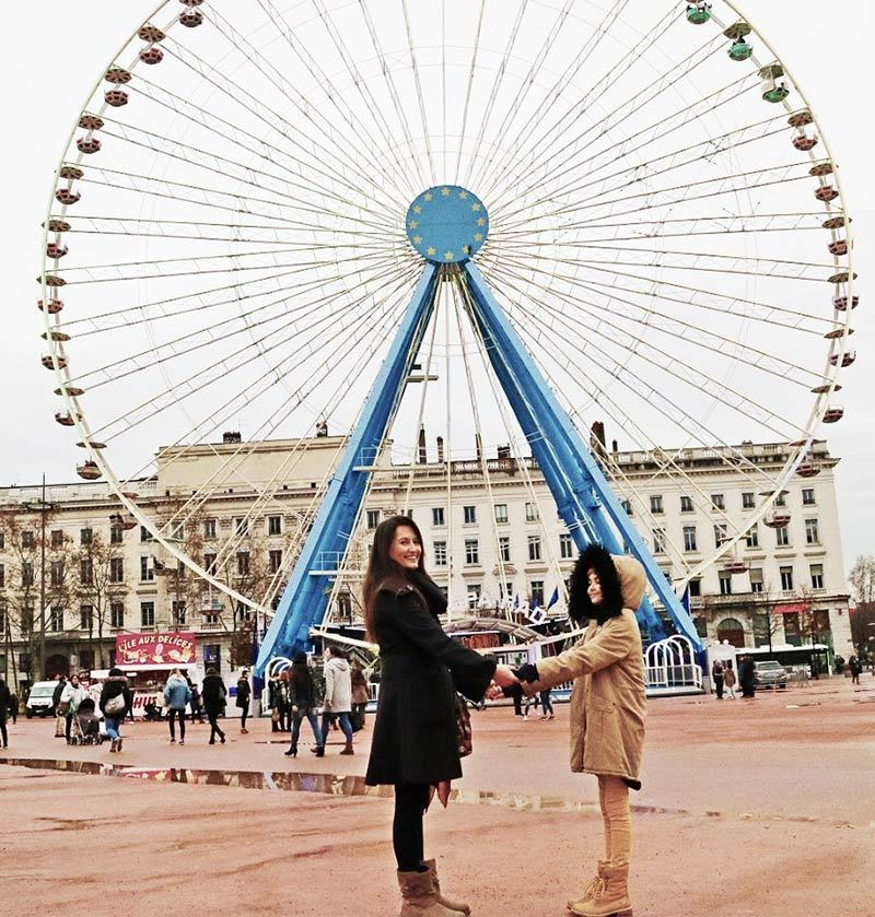 Annie And Catherine in Lyon in front of the Ferris Wheel