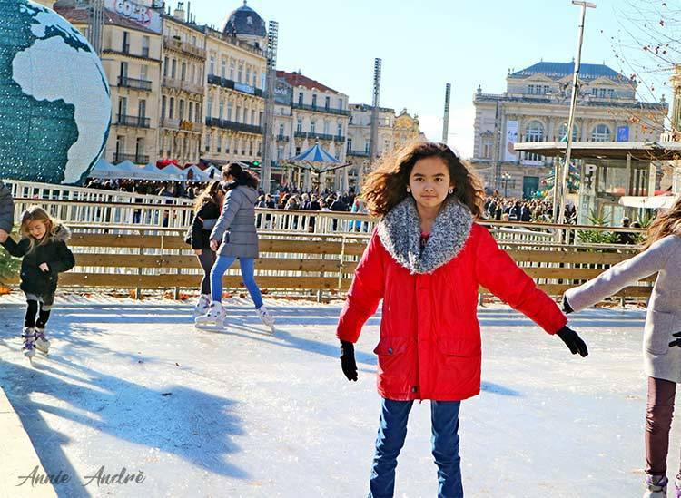 ice skating in Montpellier during Christmas with place de la comédie in background