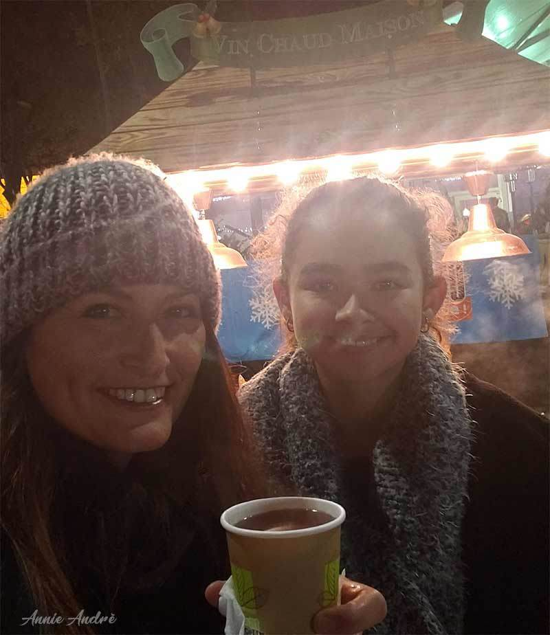 photo drinking vin chaud (mulled wine) at a French Christmas market in France