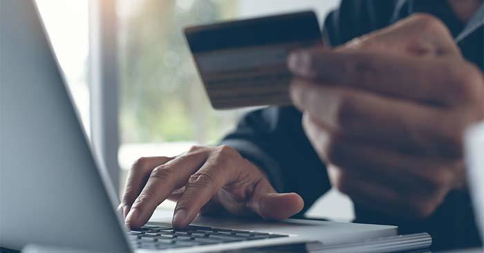 photo of someone shopping with a credit card online