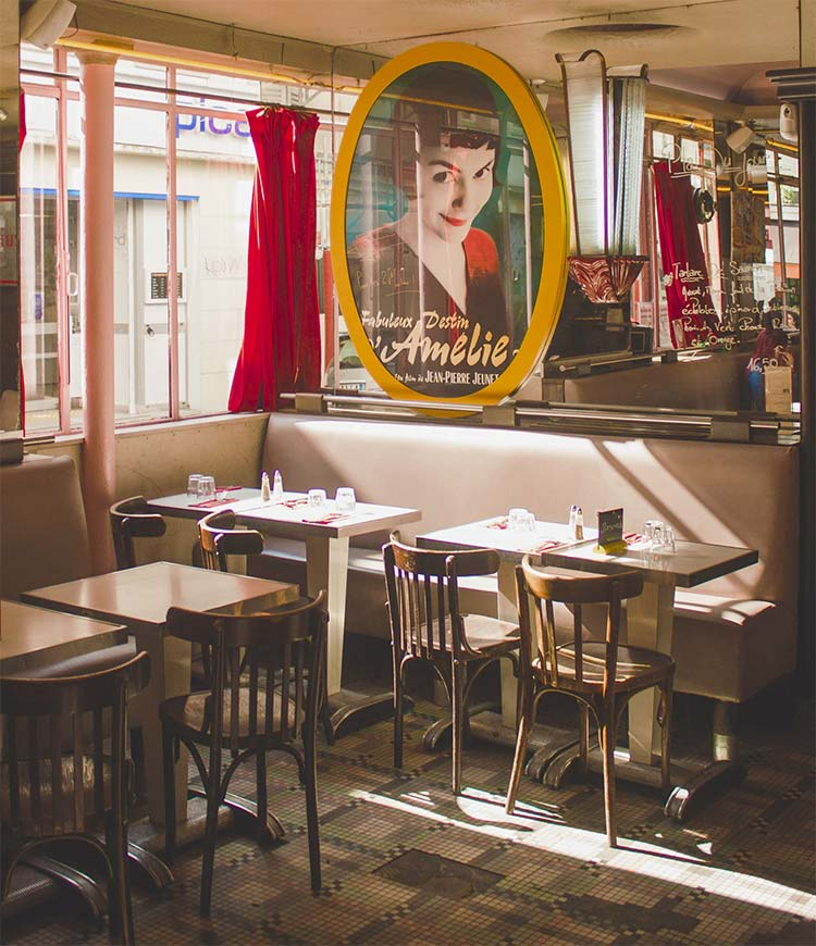 interior of cafe des 2 moulin with poster from the movie Amélie