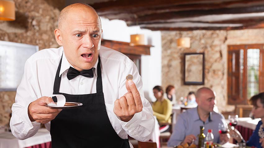 Tipping French waiter in France
