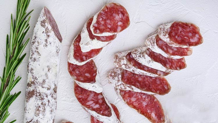 Dry cured fuet salami sausage slices: charcuterie board meat